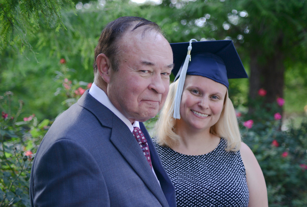 Academic Stands with Her Father