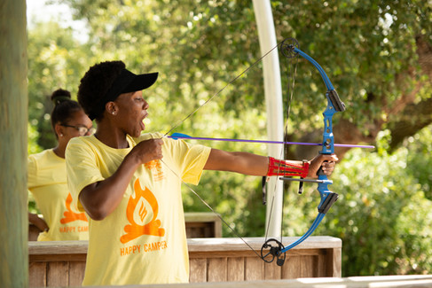 Teen releasing bow and arrow