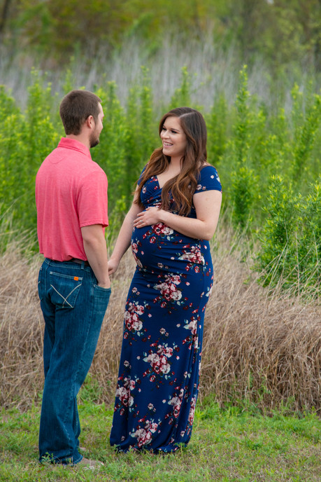 Parents talk to each other during maternity photoshoot.