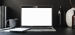 macbook-pro-on-black-table-3787591.jpg