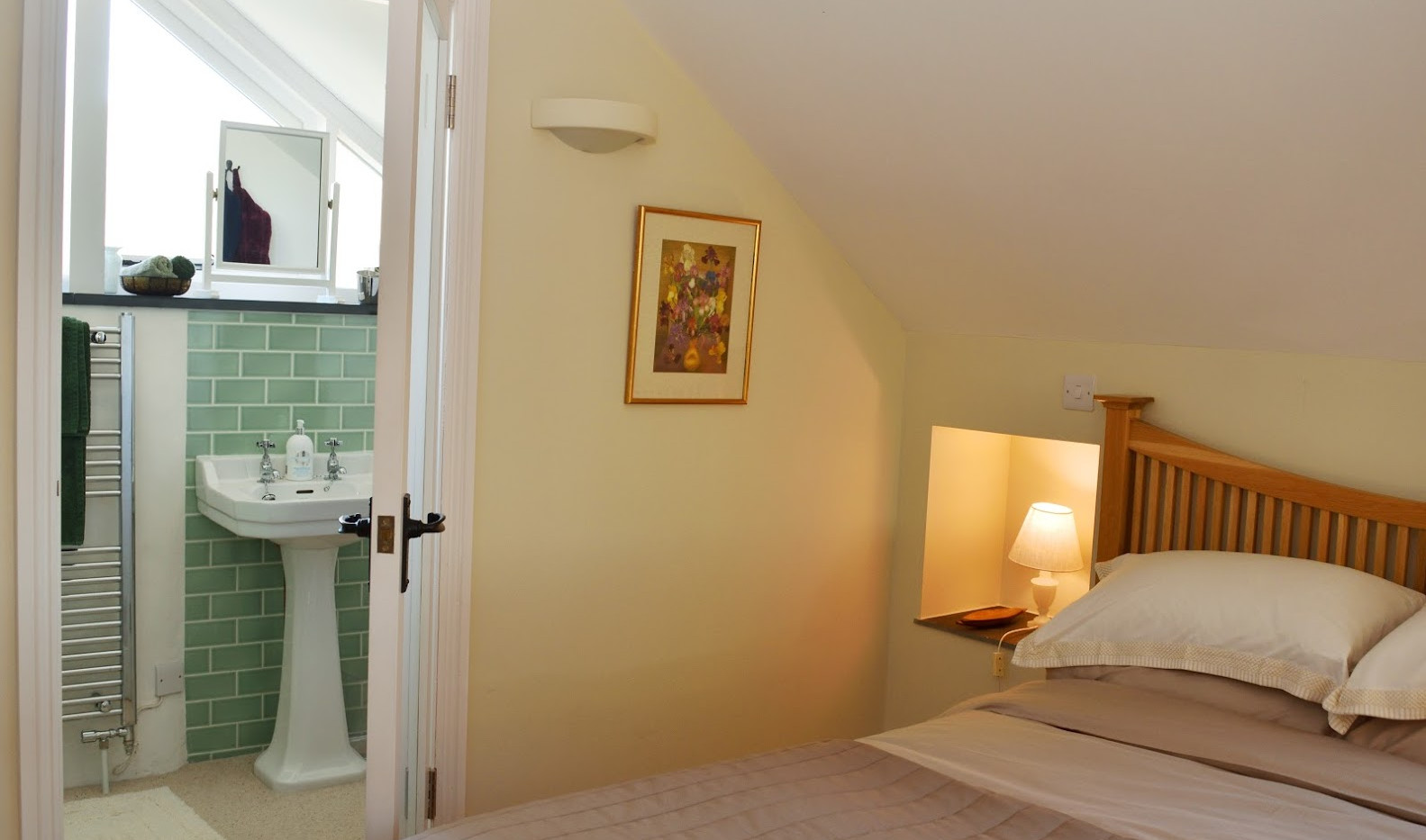Bedroom with ensuite shower room and heated towel rail