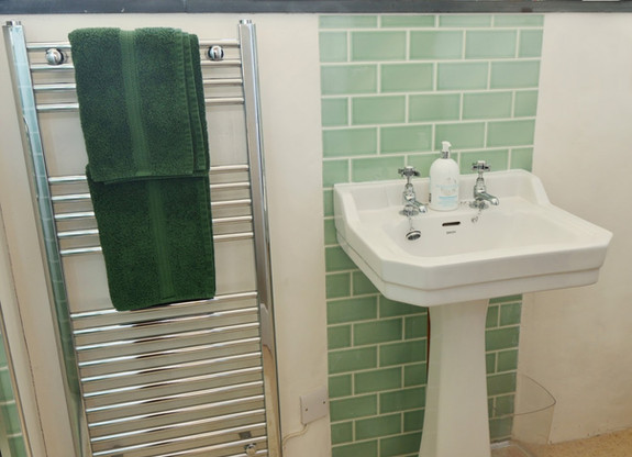 Ensuite shower room with heated towel rail