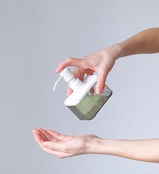 Canva - Woman Applying Hand Sanitizer.jp