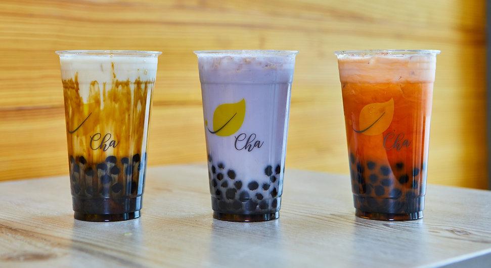 Large Boba Teas on Table. Roasted Brown Sugar Latte, Taro Milk Tea, and Thai Milk Tea.