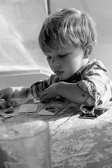 kid looking at photos bw (1 of 1).jpg