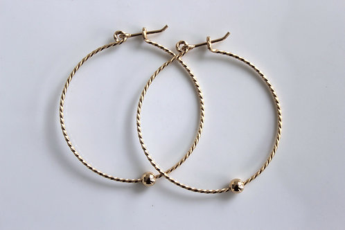 Twisted gold on gold hoops