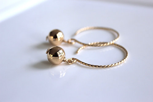 Gold on gold open hoops