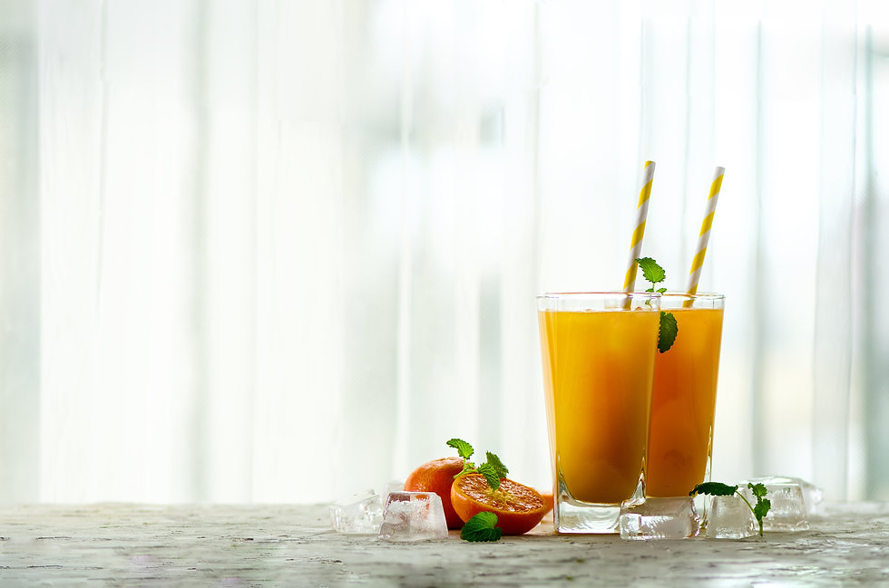 fresh-orange-juice-mint-and-ice-on-white