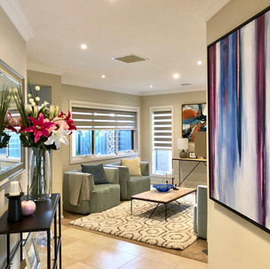 Home styling in Melbourne with modern abstract art by Matejka Interiors. Hallway/livingroom