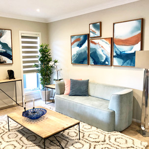 Home styling in Melbourne with modern abstract art by Matejka Interiors. Livingroom