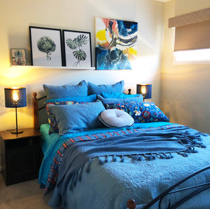 Home styling in Melbourne with modern abstract art by Matejka Interiors. Bedroom 1