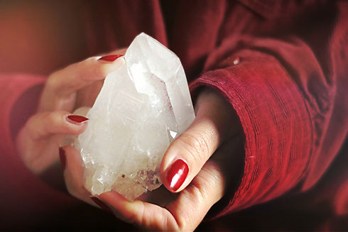 close-up-photo-of-person-holding-crystal