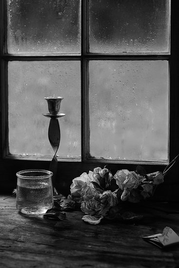 Still life with candle and roses