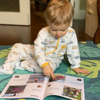 Child reading a monthly family album