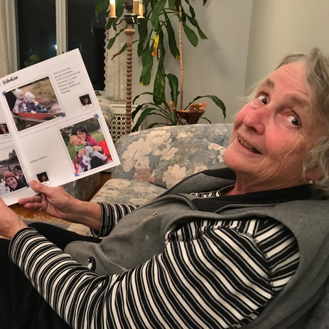 Senior mom reading news from her family
