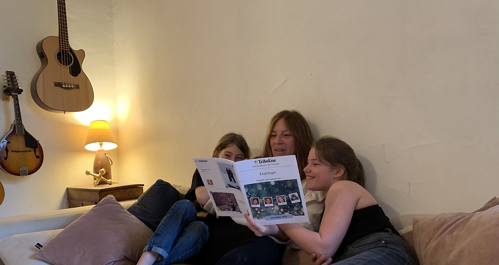 Family reading a TribeUne album