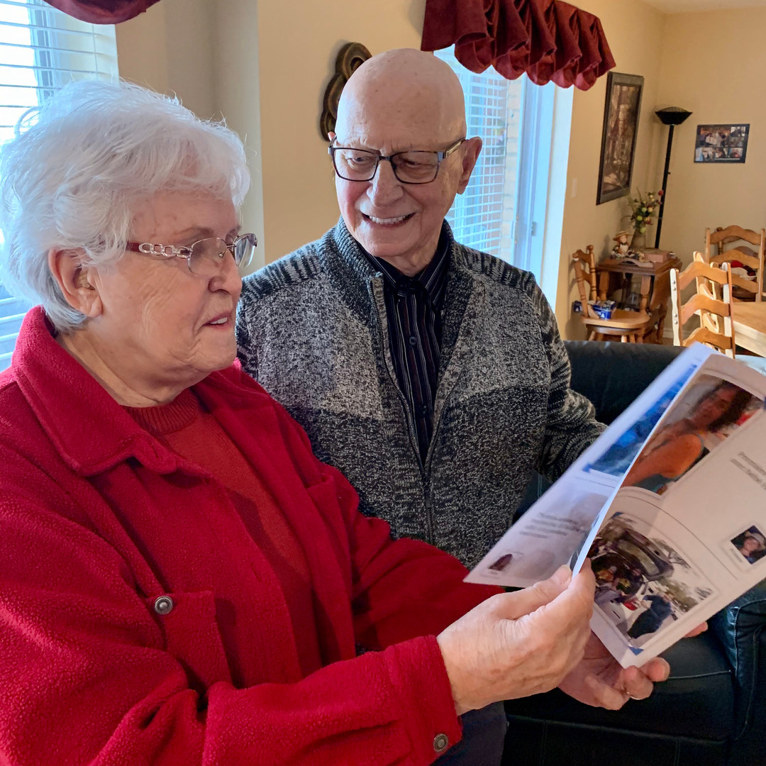 Grandparents receiving news from their family