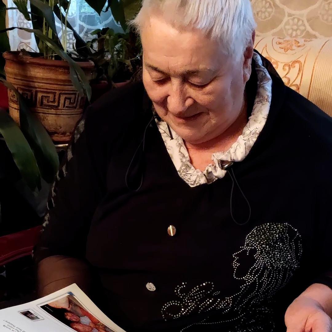 Grandmother reading monthly family journal
