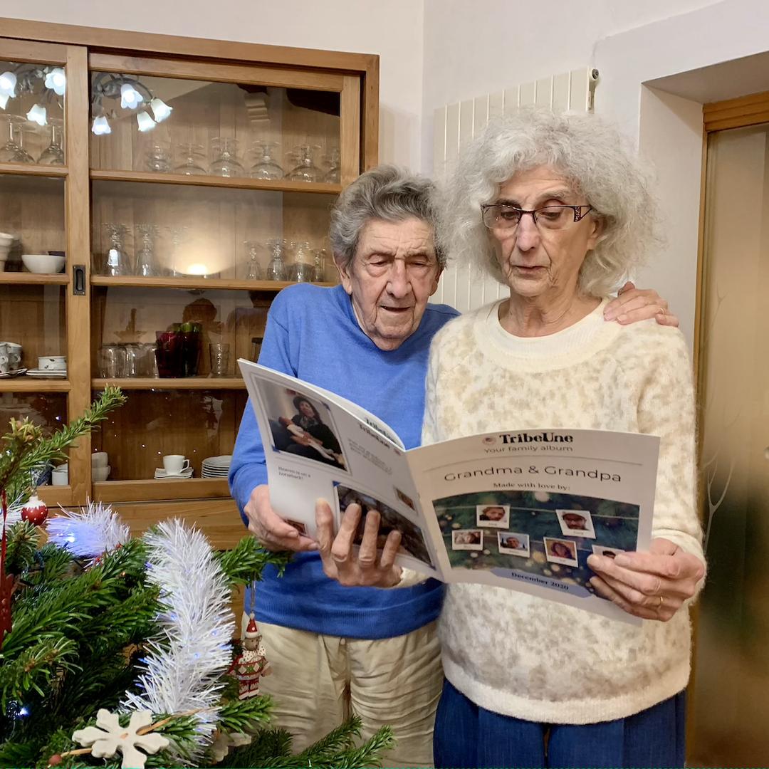 Grandparents reading family journal