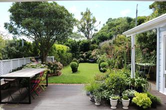 Open plan indoor outdoor sunny back garden