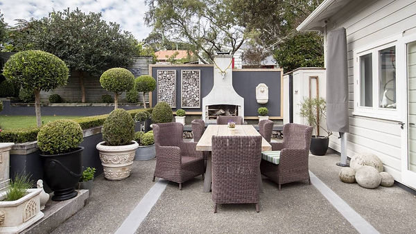 outdoor fireplace and topiary