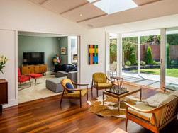 Indoor outdoor living opens onto large sunny flat lawn