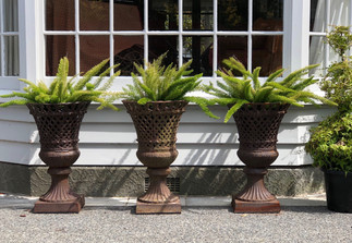 French lattice cast iron urns