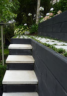Black retaining & white concrete paving