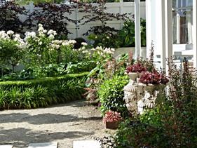 Entrance garden full of seasonal flowers & foliage