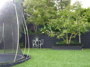 Sunken trampoline in the back garden