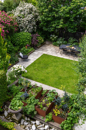 Beautiful lawn framed by concrete pavers