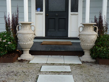 A pair of beautiful urns at the front door