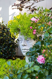 Garden art - statue with succulent hair