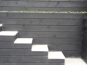 Black timber retaining walls & concrete pavers