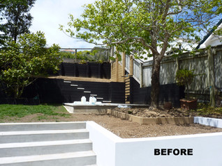 Work in progress - levelling, retaining in concrete plaster block & staining