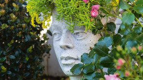 The lady of the garden greets visitors