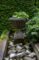 Concrete urn set in a water feature
