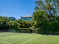 A view from the tennis court looking back to the house