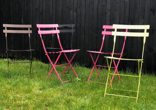 Pops of colour provided by French bistro chairs