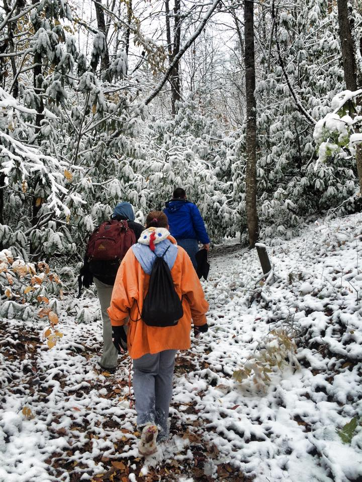 Kids hike in the snowy mountains