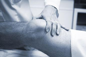 Doctor examining someone's hurt knee