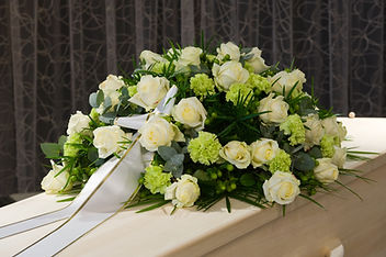 A coffin with a flower arrangement in a