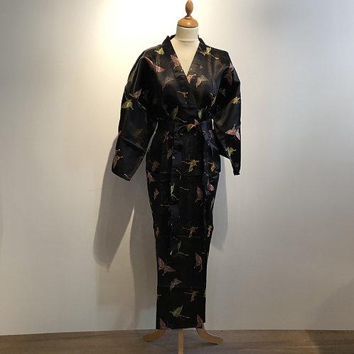 Kimono  100% polyester made in China, maar met een vlinder print.