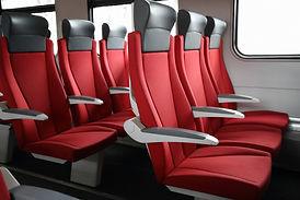 rows of red seats in modern train.jpg