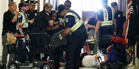 Dragged-from-wheelchair-and-arrested-at-
