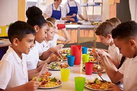 Children eating school lunch.jpg