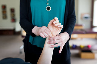 Physical therapist treating extremity pain