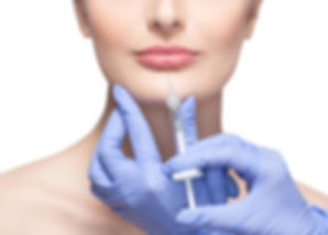 The doctor cosmetologist makes botox inj