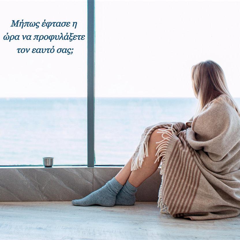 sad-woman-sitting-on-a-warm-floor-in-a-s