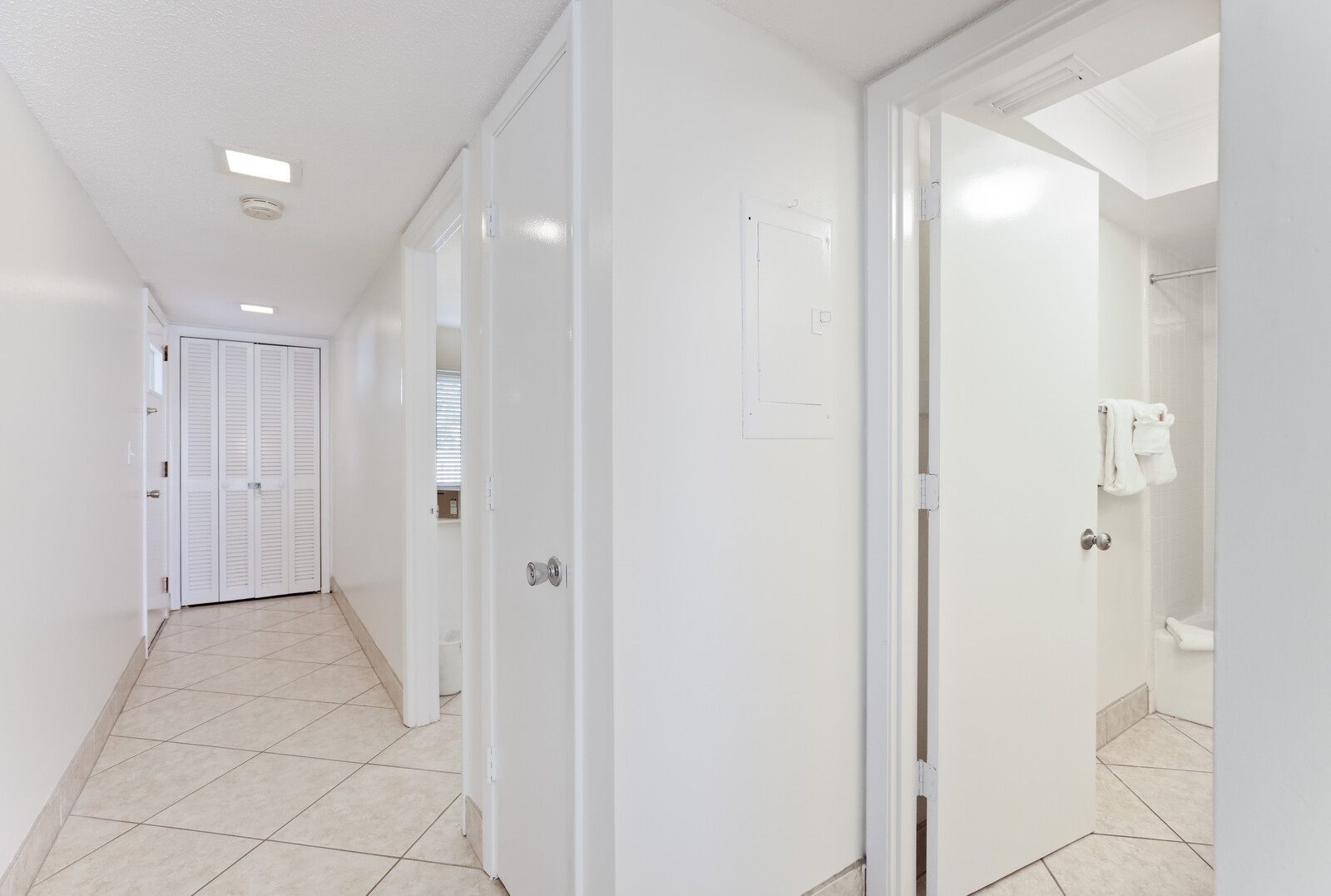 Hallway to bedroom and bathroom